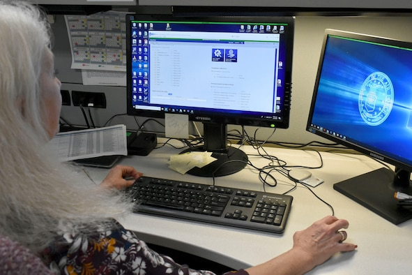 Donna Johnson, AFIMSC support agreement manager, reviews documents loaded into the Support Agreements Management Tool, or SAM-T.