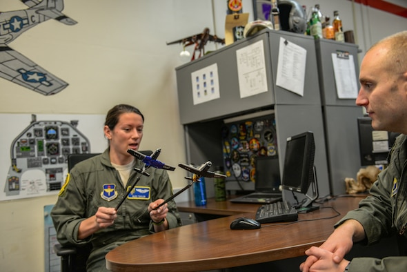 First Lt. Alexandra Taylor, 37th Flying Training Wing T-6 instructor pilot, discusses formation flying with Capt. James Tillinger, 37th FTS member, Jan. 27, 2020, at Columbus Air Force Base, Mississippi. Prior to becoming an IP, Taylor was a graduate of Specialized Undergraduate Pilot Training at Columbus AFB. (U.S. Air Force photo by Airman Davis Donaldson)