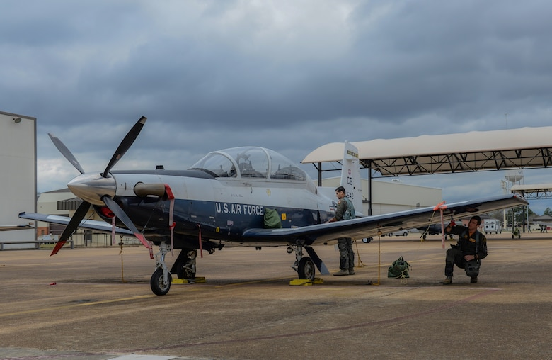 Second Lt. Rafael Galvoa, 37th Flying Training Squadron student pilot, and 1st Lt. Thomas Buckley, 37th FTS instructor pilot, conduct pre-flight checks on a T-6 Texan II, Jan. 24, 2020, at Columbus Air Force Base, Mississippi. Prior to becoming an instructor pilot, pilots must complete the Pilot Training Course at Randolph Air Force Base. (U.S. Air Force photo by Airman Davis Donaldson)