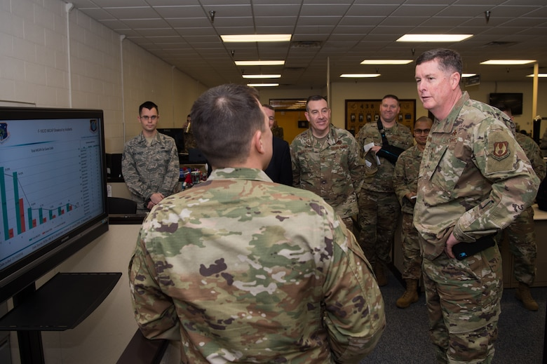 U.S. Air Force Lt. Gen. Gene Kirkland, Air Force Sustainment Center commander, receives a brief from a 735th Supply chain Operations Group Airmen during his visit to Joint Base Langley-Eustis, Virginia, Jan. 28, 2020. Made up of the 438th Supply Chain Operation Squadron, 439th SCOS, 440th SCOS and the 441st Vehicle Support Chain Operation Squadron, the 735 SCOG delivers logistics capabilities to the entire Air Force. (U.S. Air Force photo by Senior Airman Tristan Biese)