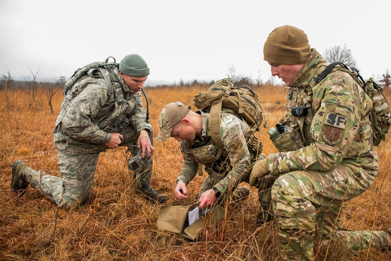 Senior Master Sgt. Bradley Rose, 185th Security Forces Squadron, left, Staff Sgt. Jonathan Finer, 124th SFS, and Master Sgt. Gregory Wardle, 153rd SFS, tackle a land navigation element Jan. 23, 2020, at Fort Chaffee, Arkansas. The team of Airmen from across the Air National Guard gathered to train for the Air Force Defender Challenge, a security forces skills competition held in May at Joint Base San Antonio-Camp Bullis, Texas.