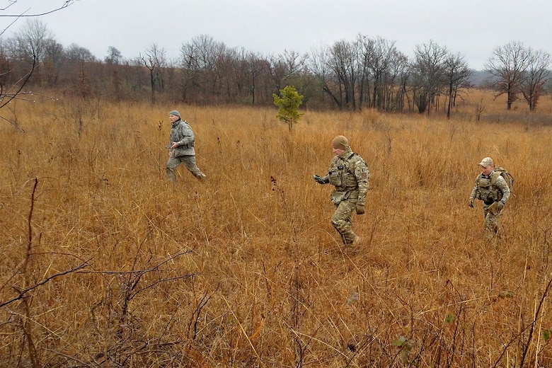 Senior Master Sgt. Bradley Rose, 185th Security Forces Squadron (from left), Master Sgt. Gregory Wardle, 153rd SFS, and Staff Sgt. Jonathan Finer, 124th SFS, tackle a land navigation course Jan. 23, 2020, at Ft. Chaffee, Arkansas. The team of Airmen from across the Air National Guard gathered to train for the Air Force Defender Challenge, a security forces skills competition. (U.S. Air National Guard photo by Master Sgt. Chauncey Reed)