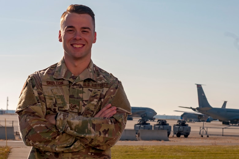 Portrait of Airman on the flight line with KC-135 Stratotanker planes in the background