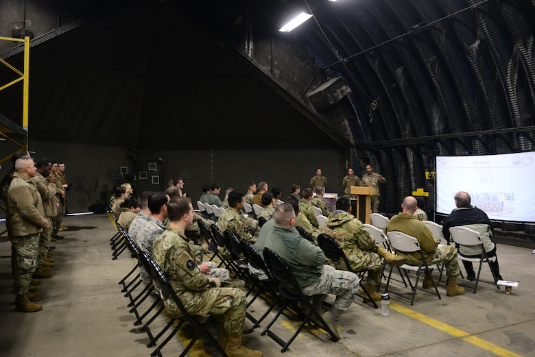 U.S. Air Force Col. Tracy T. Ward, 693rd Intelligence, Surveillance and Reconnaissance Group commander, speaks to members of the 24th Intelligence Squadron during a sunset ceremony for Eagle Vision One at Ramstein Air Base, Germany, Jan. 28, 2020. This ceremony was one of many throughout the Air Force as units relinquish the use of Eagle Vision One.  (U.S. Air Force photo by Airman 1st Class Manuel Zamora)