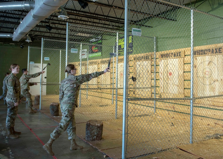 Airmen from the 4th Operational Medical Readiness Squadron throw axes at targets, Jan. 30, 2020, in Goldsboro, N.C.