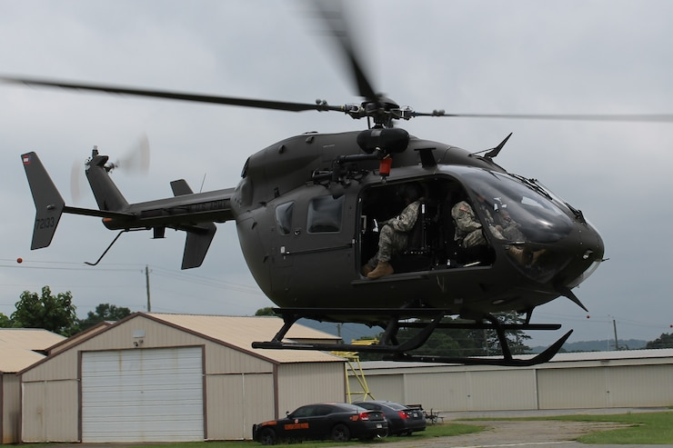 A Georgia Army National Guard Lakota Helicopter departs from Cartersville Airport after picking up a Georgia State Patrolman. Air crew members from Georgia's Army National Guard Counter Drug Task Force patrolled the skies north of Rome looking for marijuana grows Thursday. They harvested more than 20 plants thereby keeping $40,000 of dope off the streets of Georgia.