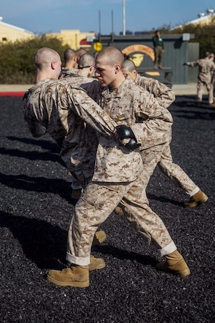 A recruit with Hotel Company, 2nd Recruit Training Battalion, executes a leg sweep during a Marine Corps Martial Arts Program class at Marine Corps Recruit Depot, San Diego, Jan. 27, 2020. Recruits were instructed to execute the different techniques step-by-step to ensure they were performed correctly. (U.S. Marine Corps photo by Lance Cpl. Grace J. Kindred)
