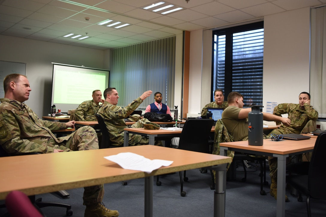 U.S. Air Advisors from the 435th Contingency Response Support Squadron have discussions during a data conference at Ramstein Air Base, Germany, Jan. 23, 2020. The air advisors brought in a consultant from the private sector to get a fresh prospective on data collection and analysis