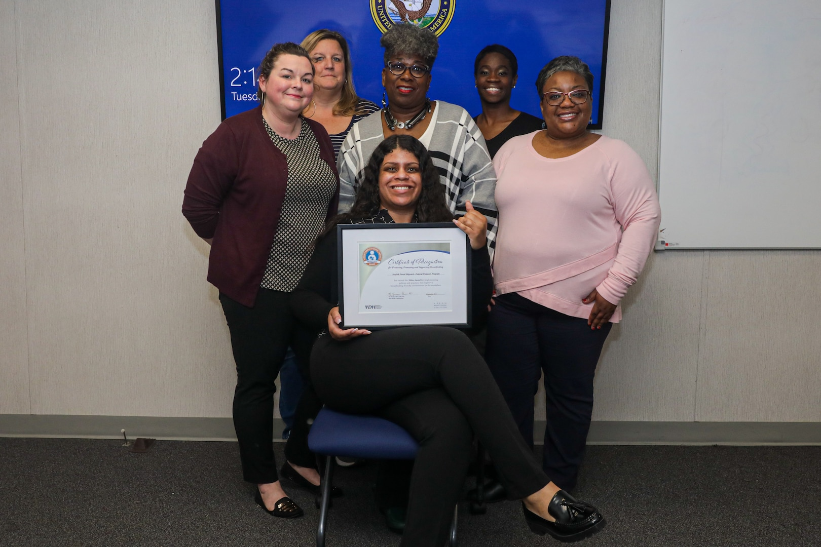 Some of the Federal Women's Program key board members with NNSY's certificate for receiving a silver rating: Waterfront Ombudsman Danielle Smith, Michelle Johnson, Public Relations Co-Chair Phyllis Scoggins, Public Relations Chair Ashley Chew, Vice President Aiya Williams, and President Carlynn Lucas.