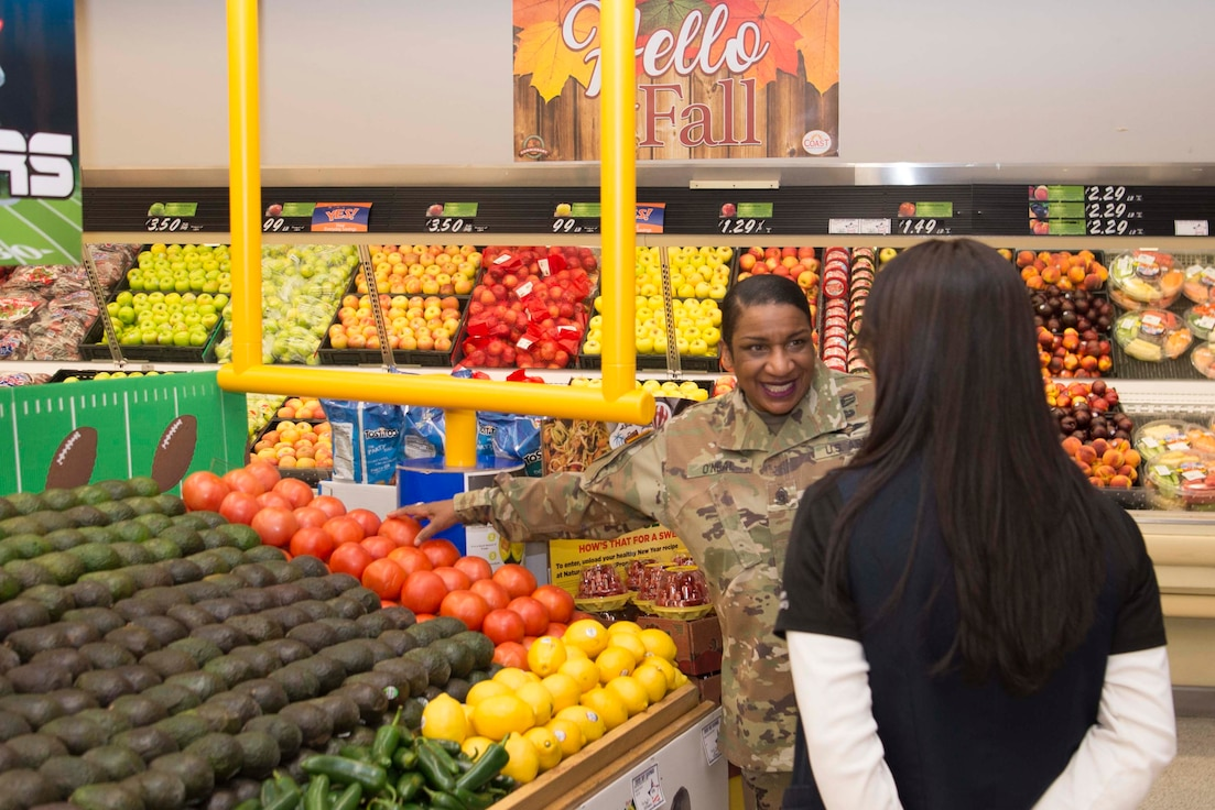 Command Sgt. Maj. Tomeka O'Neal, Defense Commissary Agency senior enlisted advisor, compliments Min Garrison, Holloman Air Force Base Commissary produce manager, on the produce section in the commissary, Jan. 30, 2020, on Holloman Air Force Base, N.M. O'Neal travels to commissary locations worldwide and focuses on the shopping experience of the commissary patrons. (U.S. Air Force photo by Airman 1st Class Quion Lowe)man