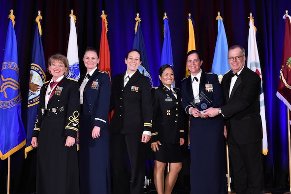 The U.S. Central Command's clinical operations team poses for a photo during an awards ceremony at the annual meeting of AMSUS, the Society of Federal Health Professionals, Dec. 5, 2019.