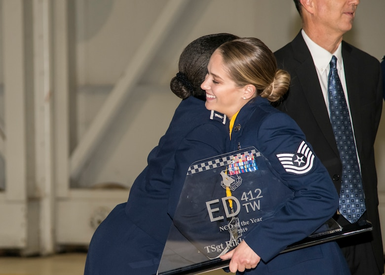 Tech. Sgt. Rikki Glowacki, the Noncomissioned Officer of the Year winner, is congratulated by her group commander, Col. Gwendolyn Foster, 412th Medical Group Commander, during the 412th Test Wing's Annual Awards Banquet, at Edwards Air Force Base, California, Jan. 31. (Air Force photo by Giancarlo Casem)
