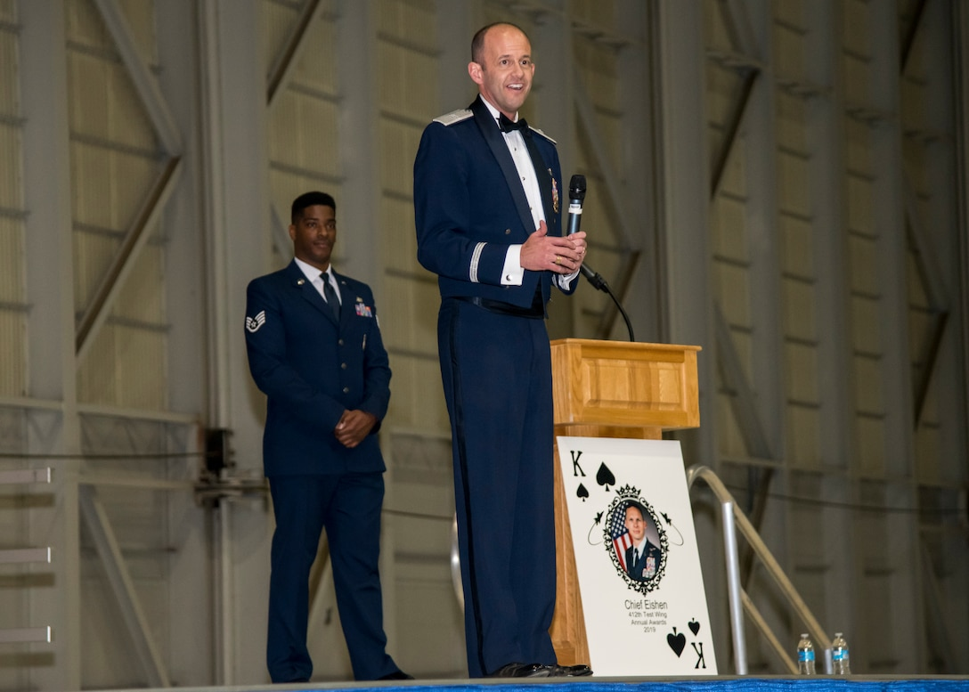 Brig. Gen. E. John Teichert, 412th Test Wing Commander, congratulates the winners and nominees during the Wing's Annual Awards Banquet, Jan. 31. (Air Force photo by Giancarlo Casem)