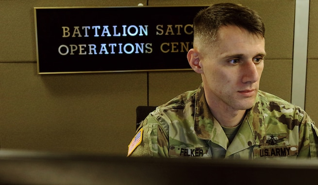 Staff Sgt. Matthew Felker, Headquarters and Headquarters Company, 53rd Signal Battalion, oversees his troops as they work in the new Battalion Satellite Communications Operations Center at Fort Carson, Colorado, as part of the U.S. Army Satellite Operations Brigade. (U.S. Army photo by Sgt. Dennis DePrisco)