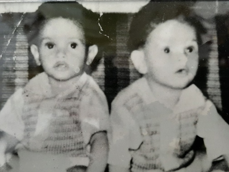 Twins Melvin Kelvin Bowen pose for a photo when they were children. The brothers grew up in the small community of East Arcadia, North Carolina, with their 12 siblings. (Courtesy photo by Kelvin Bowen)