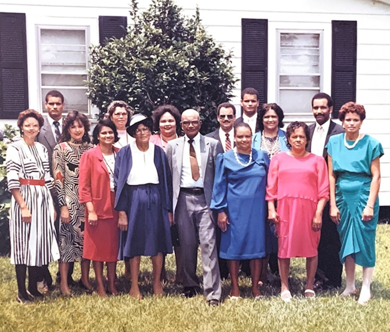 Melvin and Kelvin Bowen take a photo with their family in 1986. The brothers grew up in the small community of East Arcadia, North Carolina, with their 12 other siblings. (Courtesy photo by Kelvin Bowen)