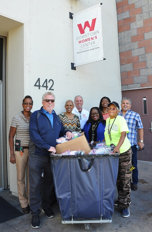 From left to right, Stephanie Hall, senior environmental protection specialist, Transportation and Special Projects Branch, U.S. Army Corps of Engineers Los Angeles District; Donald Lank, Equal Employment Opportunity manager, U.S. Army Corps of Engineers Los Angeles District; Shirley Craig, donations and inventory associate, Downtown Women's Center, Los Angeles; Hollis Champlain, Equal Employment Opportunity specialist, U.S. Army Corps of Engineers Los Angeles District; Felicia Weaver, administrative assistant, Public Affairs, U.S. Army Corps of Engineers Los Angeles District; Arnecia Williams, regional value officer, Engineering Division, U.S. Army Corps of Engineers Los Angeles District; Pauline Williams, parking attendant at the women's center; and Gerry Salas, environmental engineer, U.S. Army Corps of Engineers Los Angeles District, pose for a picture Jan. 23 in front of a cart full of toiletries donated to the center by the Corps.