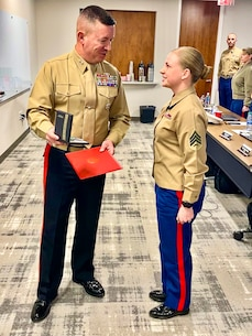 Major General James W. Bierman, Jr., commanding general of Marine Corps Recruiting Command, recognizes Sgt. Nichole Anunciacion, Marketing and Communication Marine, Recruiting Station San Francisco, 12th Marine Corps District, as the MCRC Marketing and Communication Marine of the Year during an award ceremony at Wunderman Thompson, Atlanta, Ga., February 4, 2020. Annually, MCRC selects one Recruiting Station Marketing and Communication Marine as the MAC of the year, from six Marine Corps Districts. (U.S. Marine Corps Photo by 2nd Lt. Mallory S. VanderSchans)