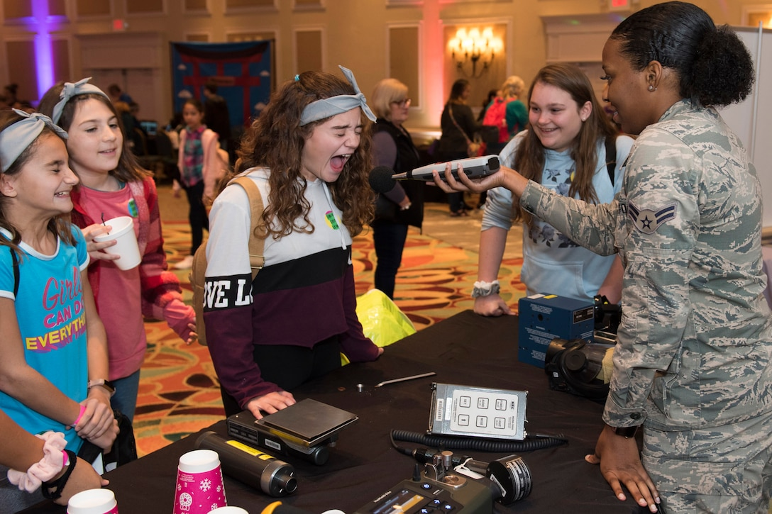Students from Sabal Elementary School in Melbourne, Fla., participate in a yelling contest with Airman 1st Class Kishona Quinn, a member of the Air Force Technical Applications Center at Patrick AFB, Fla., using a meter that measures sound levels to test exposure to hazardous noises.  The demonstrations were part of AFTAC's annual Women in Science and Engineering Symposium Pioneer Day for local school students.  (U.S. Air Force photo by Matthew S. Jurgens)