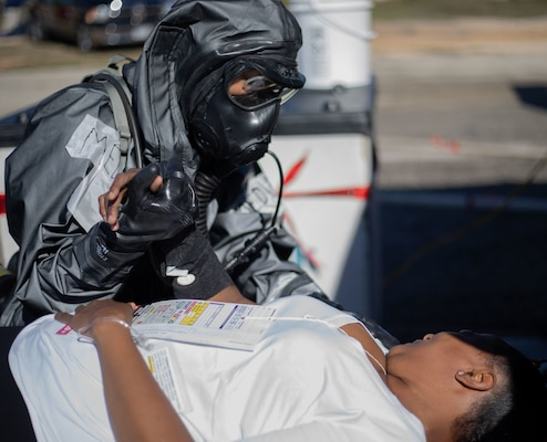 Pfc. Aryanna Tate, assigned to 546th Area Support Medical Company, comforts a role player in a simulated decontamination line Jan. 26 at Travis County Exposition Center in Austin, Texas, as part of Exercise Sudden Response 20.