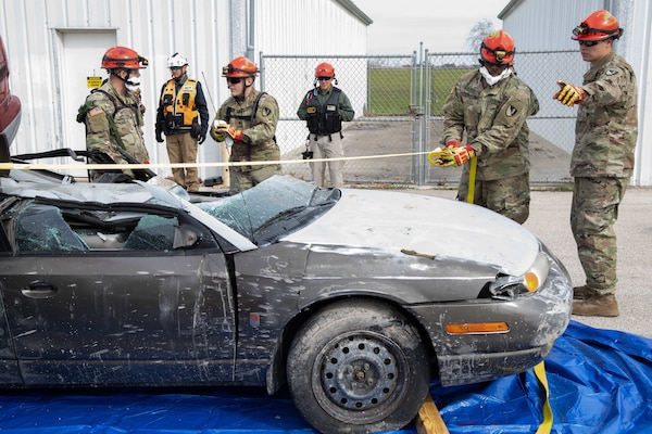 Service members assigned to the 3rd Platoon, 68th Engineer Company urban rescue team conduct a car rescue during a simulated urban search and rescue mission Jan. 25 as part of Exercise Sudden Response 20.