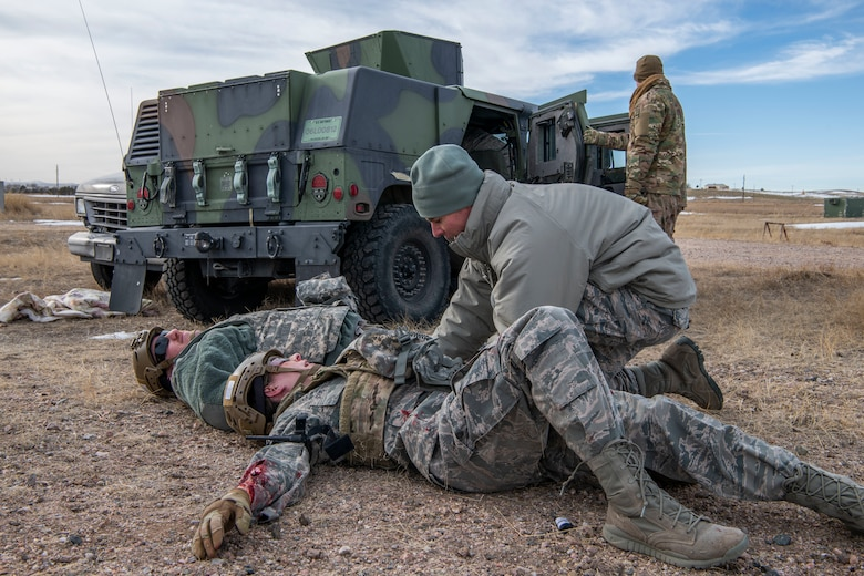 Airmen, representing the injured, have their injuries assessed during a Self Aid Buddy Care training provided by 90th Civil Engineer Squadron Explosive Ordinance Disposal flight Jan. 16, 2020, at F.E. Warren Air Force Base, Wyo. The routine training added an element of combat scenarios, allowing 90th Mission Support Group Airmen to practice SABC in a unique and potentially life threatening situation. (U.S. Air Force photo by Senior Airman Abbigayle Williams)