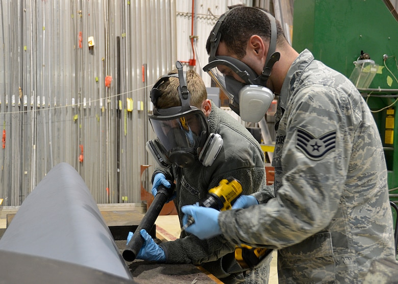 Airman 1st Class Clayton Langston (left) and Staff Sgt. Charles Swaim (right), aircraft structural maintenance technicians with the 445th Maintenance Squadron, prepare a newly received aircraft panel to be installed on a C-17 Globemaster III here Jan. 5, 2020. The new panel will protect the structure of the aircraft from debris and wear.(U.S. Air Force Photo/Staff Sgt. Ethan G. Spickler)