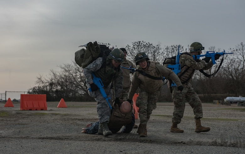 Medics move a simulated wounded patient to a safe environment for treatment at Joint Base Langley-Eustis, Virginia, January 24, 2020. The Tactical Combat Care Course helps medics become physically and mentally prepared to save lives in a hostile environment. (U.S. Air Force photo by Airman 1st Class Sarah Dowe)