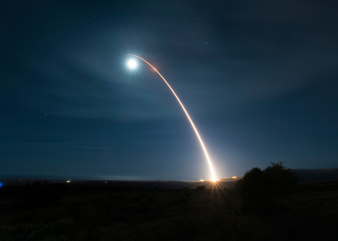 A missile launches into the sky.