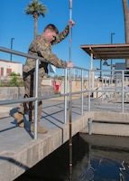 Tech. Sgt. George Vollmer, 56th Civil Engineer Squadron water and fuels systems maintainer, checks if there is proper distribution of water and sewage sludge in the water tanks Jan. 10, 2020, at the Luke Air Force Base Wastewater Plant in Ariz.