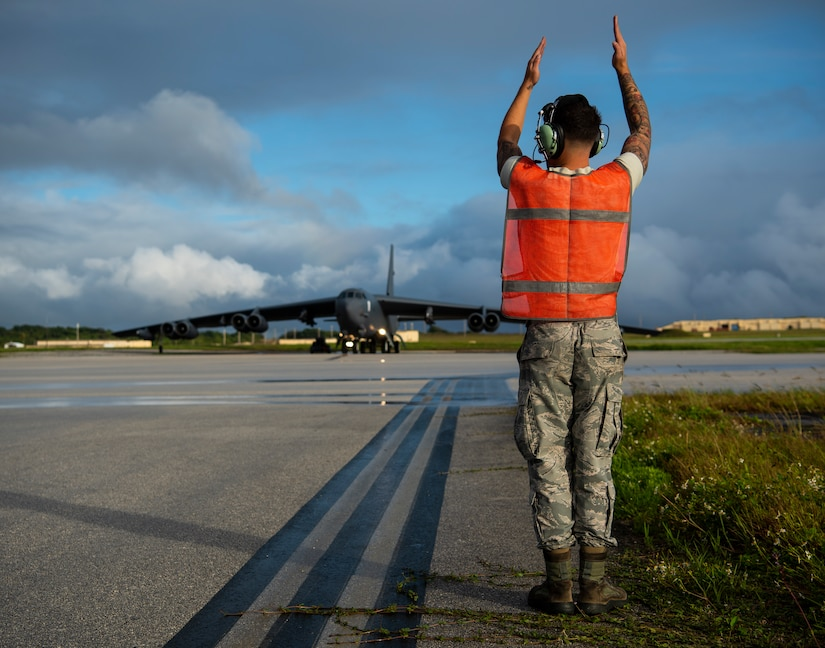Senior Airman Patrick Cervoni Valentin, 69th Aircraft Maintenance Squadron dedicated crew chief, marshals a B-52H Stratofortress before a flight at Andersen Air Force Base, Guam, Feb. 3, 2020. Strategic bomber missions enhance the readiness and training necessary to respond to any potential crisis or challenge across the globe. (U.S. Air Force photo by Airman 1st Class Michael S. Murphy)