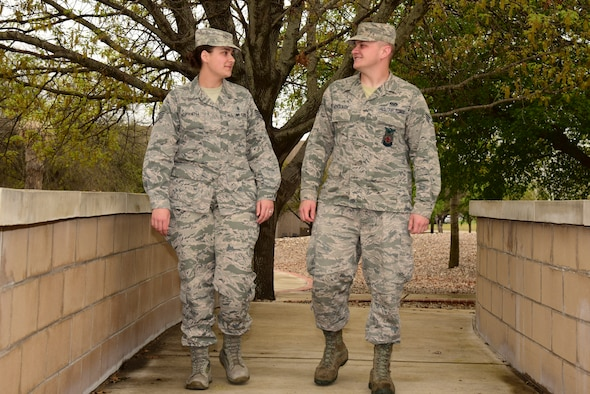 "Staff Sgt. Julie Horvath, 47th Healthcare Operations Squadron bioenvironmental technician, walks with Senior Airman Anthony Horvath, 47th Civil Engineer Squadron fire protection technician, at Laughlin Air Force Base, Texas, Feb. 28, 2019. Airmen, along with all total force personnel, are the focus of the new ""Professionalism, Airpower, Vitality and Excellence"" campaign, or PAVE program, that's coming to Laughlin. (U.S. Air Force photo by Senior Airman Anne McCready)"