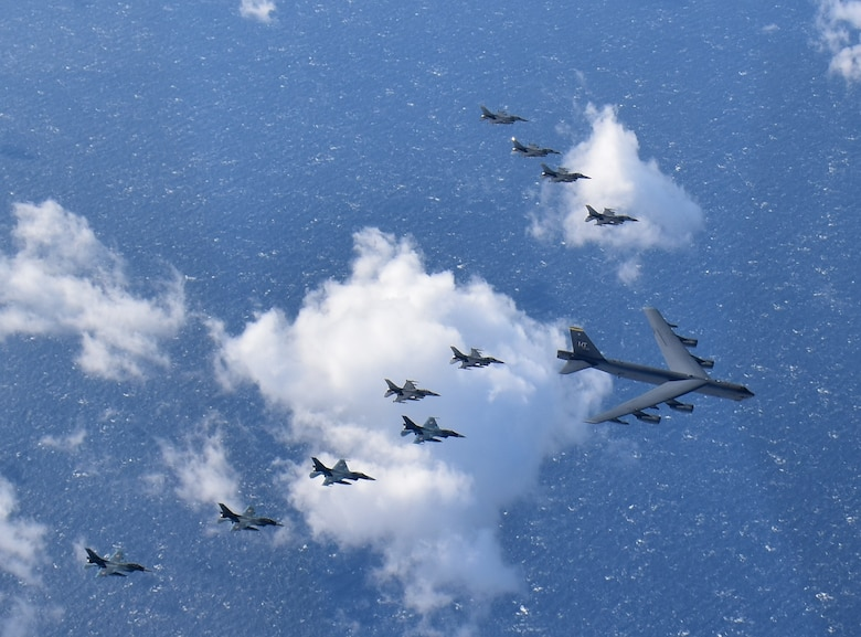 A U.S. Air Force B-52H Stratofortress from Minot Air Force Base, North Dakota, six F-16 Fighting Falcons and four Japan Air Self-Defense Force F-2s from Misawa Air Base, Japan, fly in formation off the coast of Northern Japan as part of a combined Continuous Bomber Presence and Bomber Task Force mission, Feb. 3, 2020. U.S. Strategic Command's bomber forces regularly conduct combined theater security cooperation engagements with allies and partners, demonstrating U.S. capability to command, control and conduct bomber missions around the world. (Courtesy photo by the Japan Air Self-Defense Force)