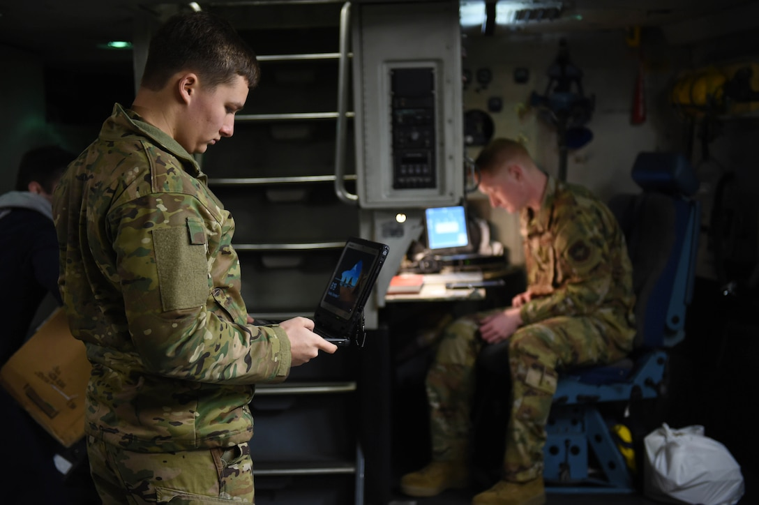 Airman 1st Classes Ryan Nelson and Kam Watt, 4th Airlift Squadron loadmasters, complete their pre-flight checklists aboard a C-17 Globemaster III before taking off from Spangdahlem Air Base, Germany, Dec. 18, 2019. The loadmaster pre-flight checklist includes things like making sure the oxygen masks are functional and that any cargo is safely secured. (U.S. Air Force photo by Airman 1st Class Mikayla Heineck)