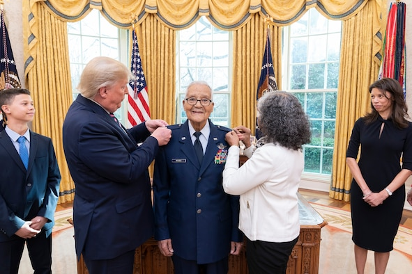 President Donald J. Trump participates in the promotion pinning ceremony for State of the Union Gallery guest and Tuskegee Airman, retired Brig. Gen. Charles McGee, Feb. 4, 2020, in the Oval Office of the White House. (Official White House photo by Shealah Craighead)
