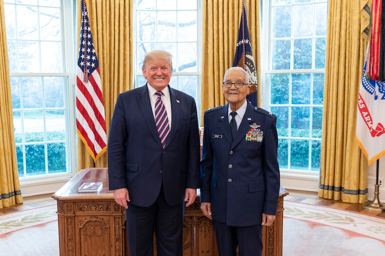 President Donald J. Trump welcomes State of the Union Gallery guest and Tuskegee Airman, retired Col. Charles McGee, Feb. 4, 2020, to the Oval Office of the White House before McGhee's promotion to brigadier general. (Official White House Photo by Shealah Craighead)
