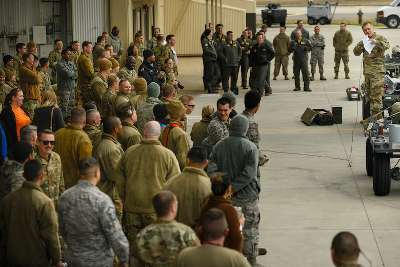 Tech. Sgt. Vasiliy Zorin, 4th Aircraft Maintenance Squadron, loading standardization crew, briefs a crowd of spectators and participants of the quarterly Load Crew Competition at Seymour Johnson Air Force Base, N.C., Jan. 24, 2020.