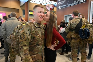 Photo of Staff Sgt. Benjamin Nelson being greeted by his fiance at Hector International Airport, Fargo, N.D., upon his completion of six-month deployment Feb. 5, 2020.