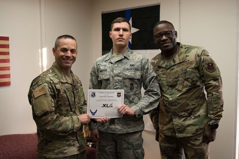 "Staff Sgt. James Shanahan, 47th Security Forces Squadron trainer, accepts the ""XLer of the week"" award from Col. Lee Gentile, the 47th Flying Training Wing Commander, and Chief Master Sgt. Brian Lewis, 47th Operations Group superintendent, on Jan. 29, 2020 at Laughlin Air Force Base, Texas. The ""XLer of the Week"" award is given to those who consistently make outstanding contributions to their unit and the Laughlin mission. (U.S. Air Force photo by Senior Airman John A. Crawford)"