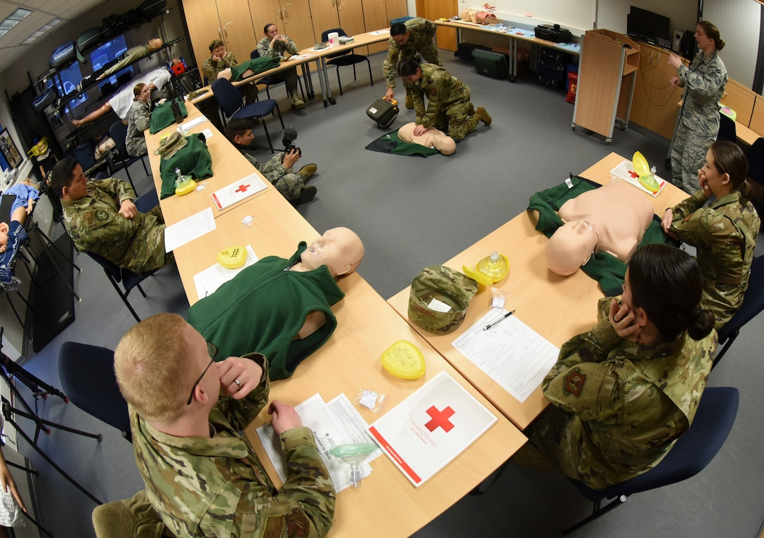 U.S. Air Force Airmen learn how to perform cardiopulmonary resuscitation during an adult CPR and automated external defibrillator class at Ramstein Air Base, Germany, Feb. 4, 2020. The 86th Medical Group education and training program has 40 CPR instructors across Ramstein and several geographically separated units. Active-duty service members with duty requirements and personnel seeking to become physical training leaders may sign up for CPR and AED classes or other life-saving courses.