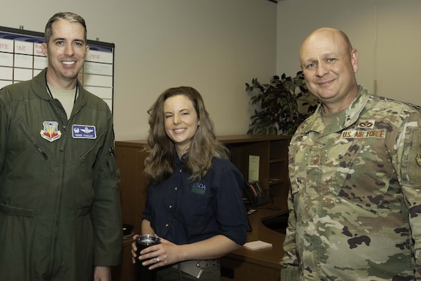 A picture of the weasel of the week with the commander and command chief.