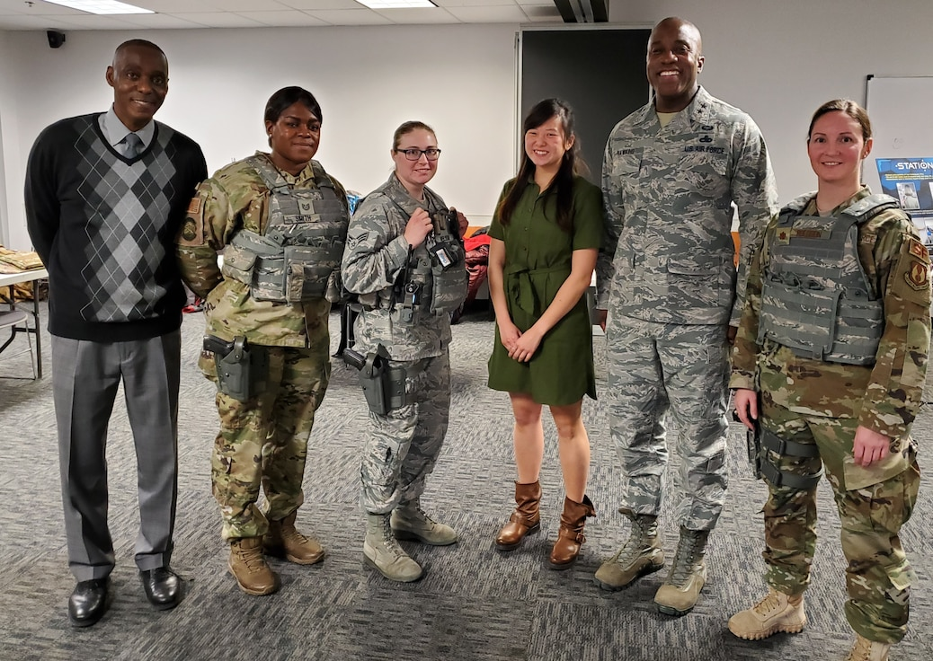 Maj. Gen. Stacey Hawkins (center right), the Director of Logistics, Civil Engineering, Force Protection and Nuclear Integration for Air Force Materiel Command, visited with members of the Air Force Life Cycle Management Center's Human Systems Program Office and the 88th Security Forces Squadron, to discuss the program office's efforts to acquire body armor for female Airmen that fits properly. (U.S. Air Force photo / Brian Brackens)