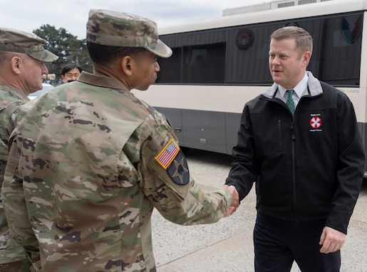 Col. Wheeler R. Manning, commander, 403rd Army Field Support Brigade, greets Secretary of the Army Ryan D. McCarthy as he arrives at Camp Carroll, South Korea, Jan. 29.