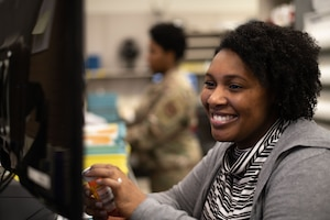 Gabrielle Ervin, Maxwell Pharmacist, looks over a patient's information while sorting prescriptions at the Maxwell Pharmacy, Dec. 19, 2019, Maxwell Air Force Base, Alabama. The Maxwell Pharmacy is responsible for serving the 42nd Air Base Wing, Air University and all of the other tenant units on base, as well as communities across the state of Alabama. (U.S. Air Force photo by Senior Airman Alexa Culbert)