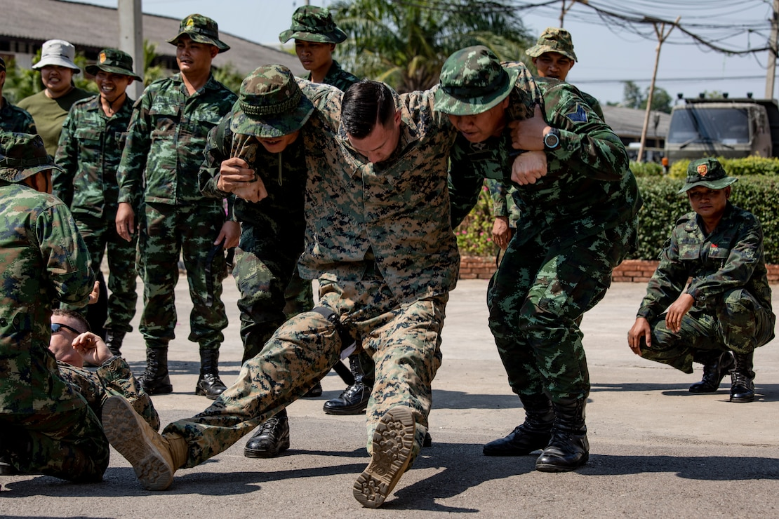 Service members with the Royal Thai Armed Forces carry a U.S. Marine during a supplemental landmine casualty care event on Banuransgri Camp in Ratchaburi Province, Kingdom of Thailand, Jan. 29.