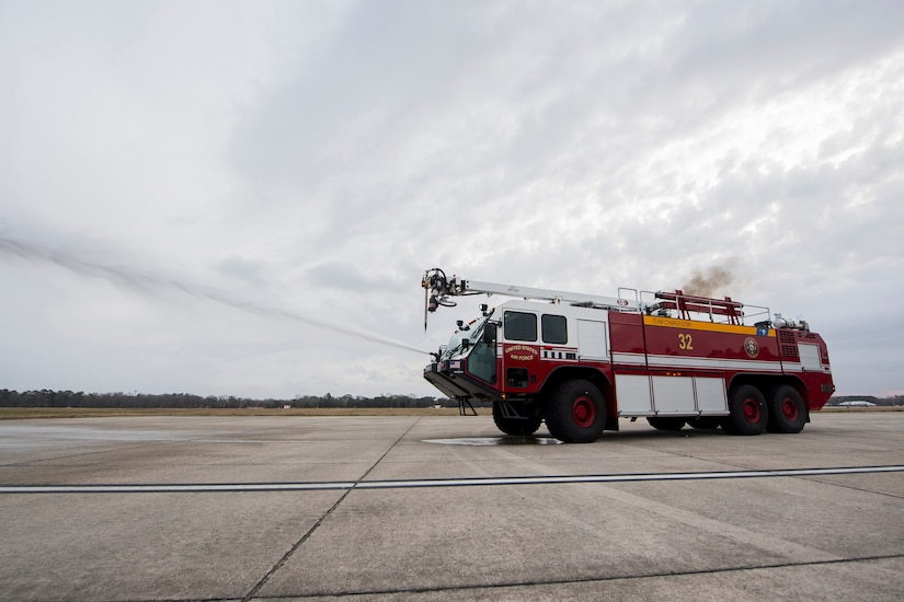 Matthew Callaghan, a firefighter assigned to the 628th Civil Engineer Squadron, sprays water from a firetruck during an operations check at Joint Base Charleston, S.C., Feb. 6, 2020. The base fire department runs daily operations to maintain readiness in case of emergencies such as structure or aircraft fires, injury and other mishaps.