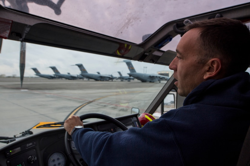 Matthew Callaghan, a firefighter assigned to the 628th Civil Engineer Squadron, inspects the flightline at Joint Base Charleston, S.C., Feb. 6, 2020. The base fire department runs daily operations to maintain readiness in case of emergencies such as structure or aircraft fires, injury and other mishaps.