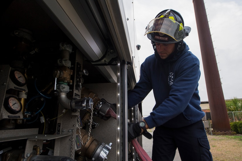 Matthew Callaghan, a firefighter assigned to the 628th Civil Engineer Squadron, attaches a hose to a firetruck to replenish its water supply at Joint Base Charleston, S.C., Feb. 6, 2020. The base fire department runs daily operations to maintain readiness in case of emergencies such as structure or aircraft fires, injury and other mishaps.