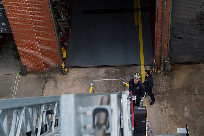 Brett Powers, a driver operator assigned to the 628th Civil Engineer Squadron fire department, controls a firetruck's bucket at Joint Base Charleston, S.C., Feb. 6, 2020. The base fire department runs daily operations to maintain readiness in case of emergencies such as structure or aircraft fires, injury and other mishaps.