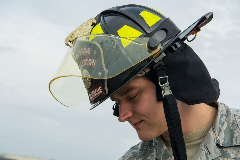 Senior Airman Nicholas Cadwell, a driver operator 628th Civil Engineer Squadron fire department, looks down from a firetruck bucket at Joint Base Charleston, S.C., Feb. 6, 2020. The base fire department runs daily operations to maintain readiness in case of emergencies such as structure or aircraft fires, injury and other mishaps.